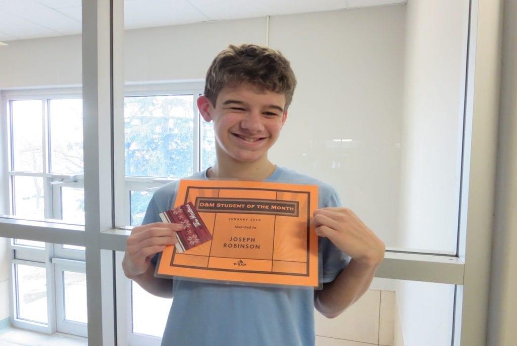 Joe receiving certificate and gift card